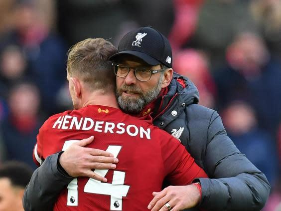 Henderson and Klopp embrace (Getty)