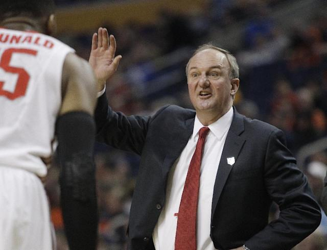 Ohio State head coach Thad Matta calls out to his team during the first half of a second-round game against the Dayton in the NCAA college basketball tournament in Buffalo, N.Y., Thursday, March 20, 2014. (AP Photo/Bill Wippert)