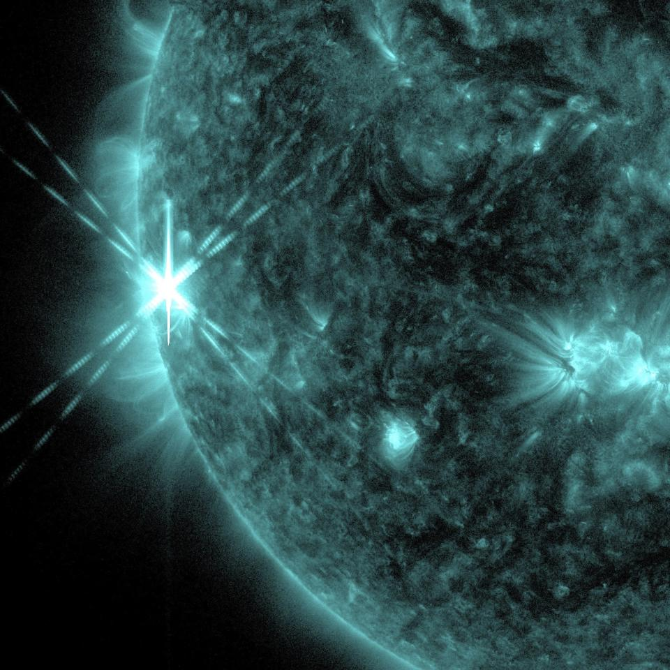 A solar flare is pictured erupting from the sun October 25, 2013 in this NASA handout photograph from its Solar Dynamics Observatory. The flare, categorized by NASA as an X1.7 class flare, was the first of three on the day. REUTERS/NASA/Handout via Reuters (OUTER SPACE - Tags: SCIENCE TECHNOLOGY ENVIRONMENT) ATTENTION EDITORS - THIS IMAGE WAS PROVIDED BY A THIRD PARTY. FOR EDITORIAL USE ONLY. NOT FOR SALE FOR MARKETING OR ADVERTISING CAMPAIGNS. THIS PICTURE IS DISTRIBUTED EXACTLY AS RECEIVED BY REUTERS, AS A SERVICE TO CLIENTS