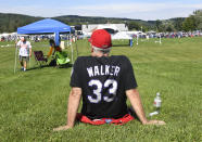 A Larry Walker Fan waits for the start of the National Baseball Hall of Fame induction ceremony at the Clark Sports Center, Wednesday, Sept. 8, 2021, in Cooperstown, N.Y. (AP Photo/Hans Pennink)
