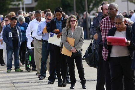People wait in line to enter the Nassau County Mega Job Fair at Nassau Veterans Memorial Coliseum in Uniondale, New York