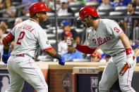 Philadelphia Phillies' Jean Segura (2) celebrates with Bryce Harper (3) after hitting a solo home run during the first inning of a baseball game against the New York Mets, Saturday, Sept. 18, 2021, in New York. (AP Photo/Mary Altaffer)