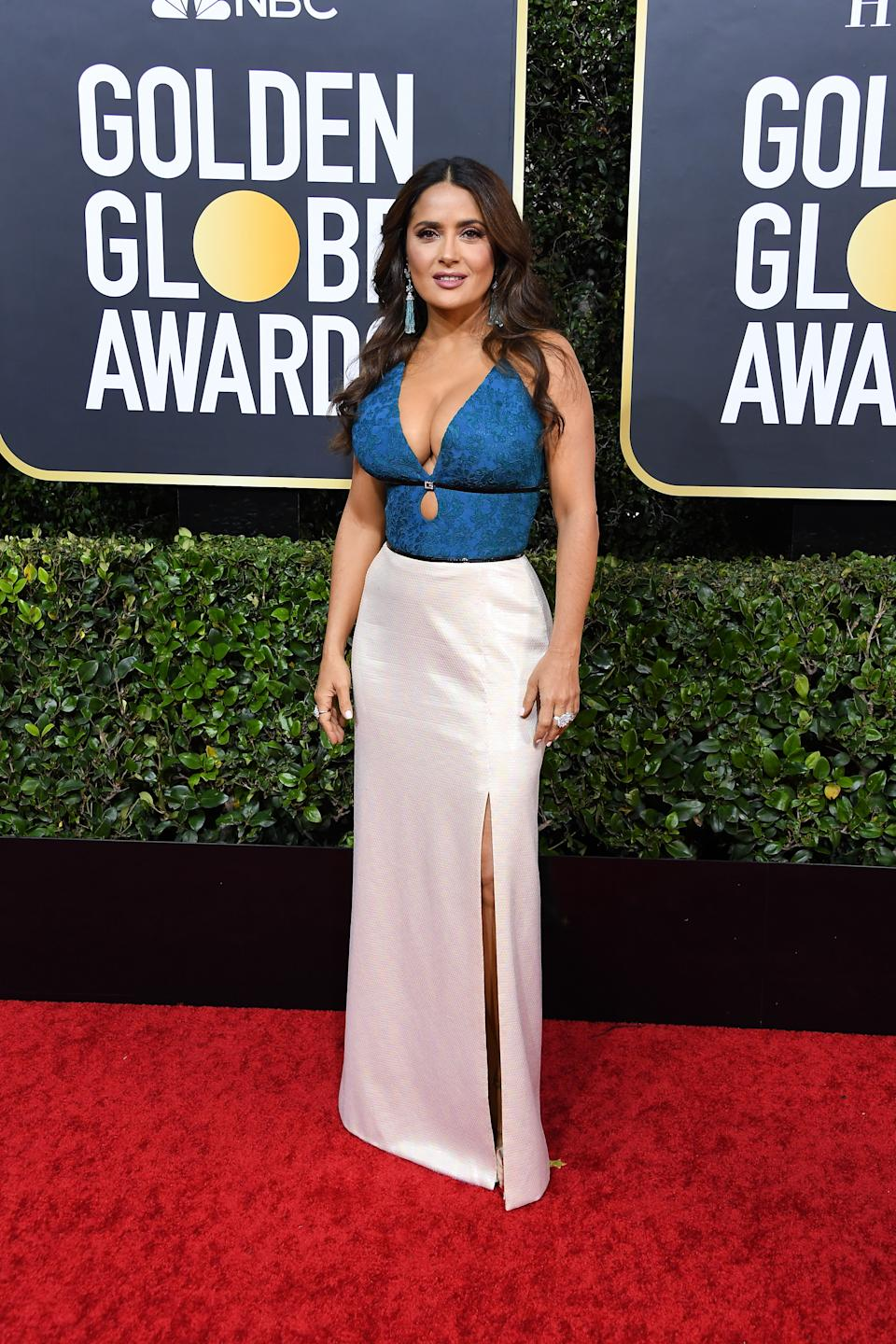 Hayek opted for a white and blue Gucci gown with cut-out details to serve as a presenter at this year's Golden Globes. (Photo by Steve Granitz/WireImage)