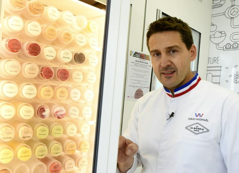 Ice cream maker David Wesmael wearing his white laboratory coat with its tricolore collar, which can only be worn by a tiny elite of the country's best craftspeople