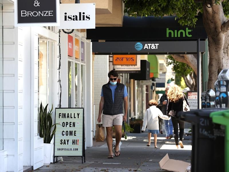 Local businesses, like these in San Francisco, are reopening.
