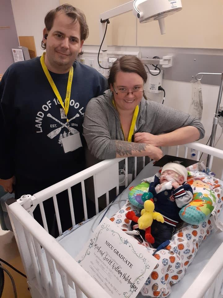 Rick and Beth Hitchinson with baby Richard, who spent six months in hospital before being allowed home. (SWNS)