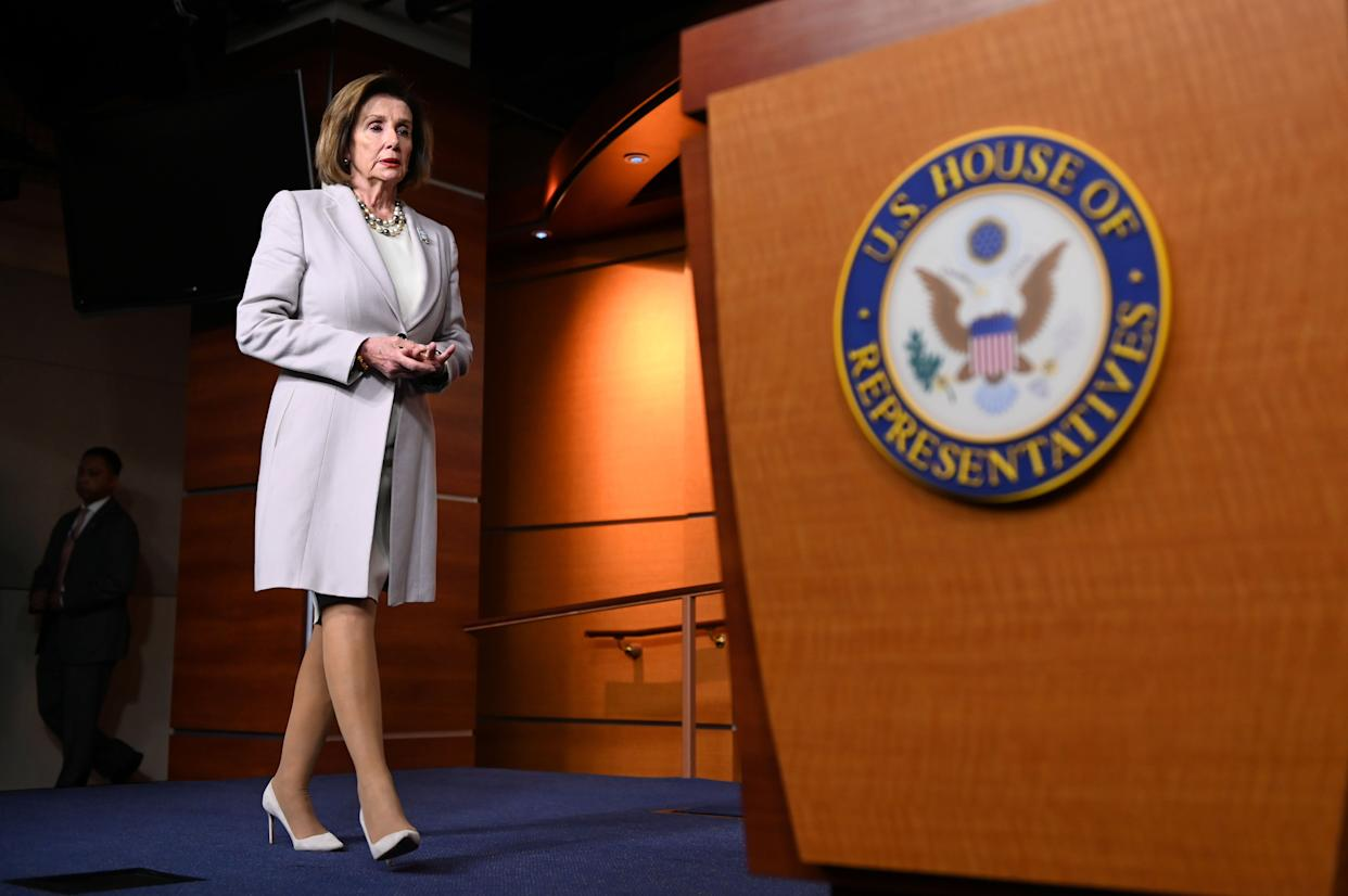 """House Speaker Nancy Pelosi arrives Thursday for a news conference on Capitol Hill. She says House Democrats are on a """"path to yes"""" on a trade deal with Canada and Mexico. (Photo: Erin Scott / Reuters)"""