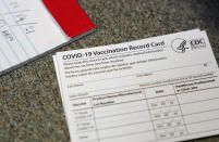 FILE - In this Dec. 24, 2020, file photo, a COVID-19 vaccination record card is shown at Seton Medical Center in Daly City, Calif. California is offering residents to access a digital record of their coronavirus vaccinations they can use to access businesses or events that require proof of inoculation. The state's public health and technology departments said Friday, June 18, 2021, the new tool will allow Californians to access their record from the state's immunization registry. (AP Photo/Jeff Chiu, File)