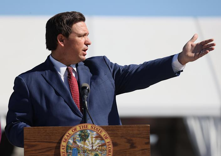 MIAMI GARDENS, FLORIDA - JANUARY 06: Florida Governor Ron DeSantis speaks during a press conference about the opening of a COVID-19 vaccination site at the Hard Rock Stadium on January 06, 2021 in Miami Gardens, Florida. The governor announced that the stadium's parking lot which offers COVID-19 tests will begin to offer COVID-19 vaccinations for residents 65 and older to drive up and get vaccinated. The vaccination site opened today for a trial run but it was not known when it will be open to the general public. (Photo by Joe Raedle/Getty Images)