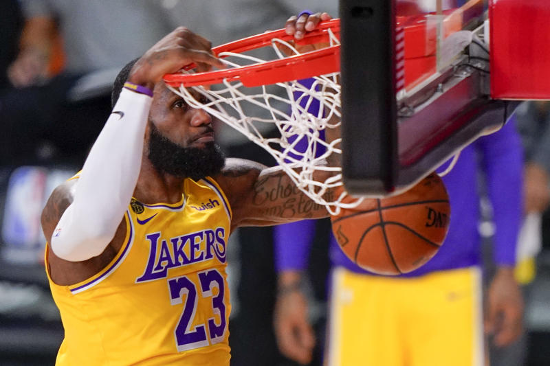 Los Angeles Lakers forward LeBron James dunks against the Miami Heat during the first half in Game 4 of basketball's NBA Finals Tuesday, Oct. 6, 2020, in Lake Buena Vista, Fla. (AP Photo/Mark J. Terrill)