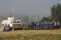 United Nations troops break up fighting in a scenario where participants playing the role of civilians fighting over water resource during the Shared Destiny 2021 drill at the Queshan Peacekeeping Operation training base in Queshan County in central China's Henan province Wednesday, Sept. 15, 2021. Peacekeeping troops from China, Thailand, Mongolia and Pakistan took part in the 10 days long exercise that field reconnaissance, armed escort, response to terrorist attacks, medical evacuation and epidemic control. (AP Photo/Ng Han Guan)
