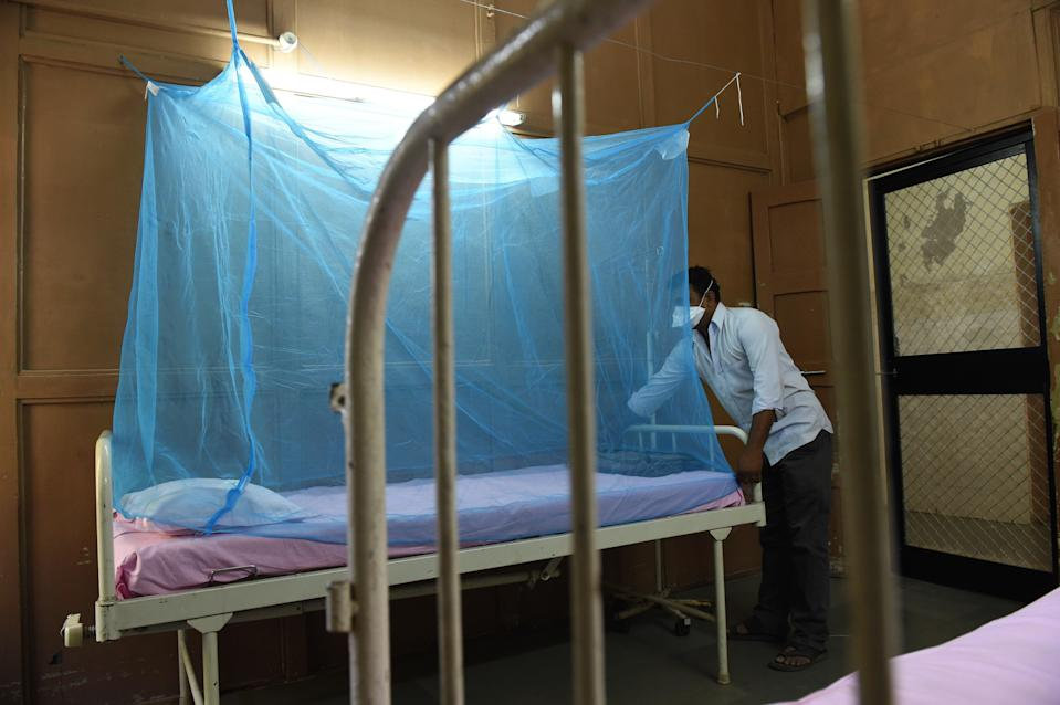 File: An attendant places a mosquito net at an isolation ward for Zika virus patients at a hospital in India's Ahmedabad city on 27 October 2018 (AFP via Getty Images)