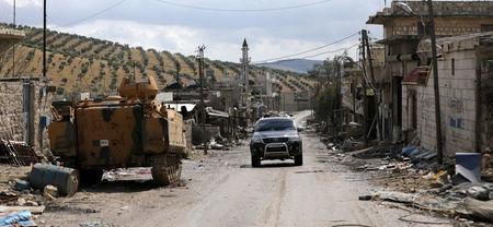 FILE PHOTO: A miltary vehicle is seen in the north east of Afrin