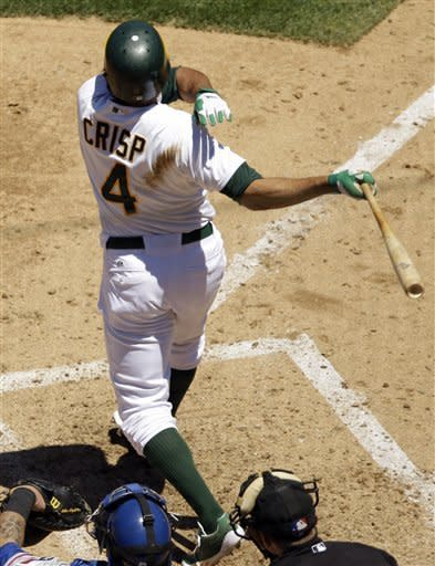 Oakland Athletics' Coco Crisp follows through on a bases-loaded triple during the fourth inning of a baseball game against the Texas Rangers on Thursday, June 7, 2012, in Oakland, Calif. (AP Photo/Marcio Jose Sanchez)