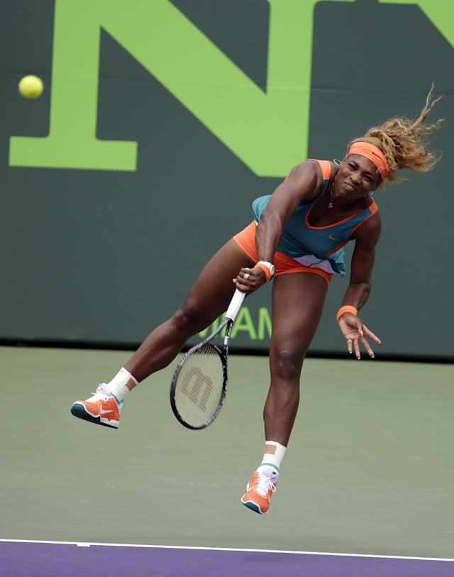 Serena Williams serves to Li Na, of China, during the women's final at the Sony Open Tennis tournament, Saturday, March 29, 2014, in Key Biscayne, Fla. (AP Photo/Lynne Sladky)