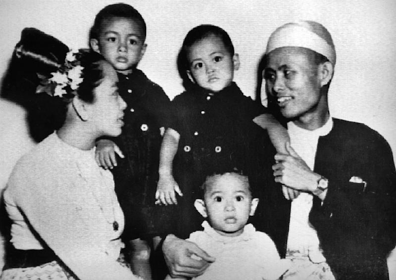 FILE - In this 1947 file photo, 2-year-old Aung San Suu Kyi, center, sits with her parents and two elder brothers. Mrs. Suu Kyi, the symbol of non-violent resistance to Burma's military rulers, won the Nobel Peace Prize Monday. Her father, Aung San, the Burmese independence leader, was assassinated on July 19, 1947 and mother, Daw Khin Kyi, died on Dec. 27, 1989 after a long illness. (AP Photo/Kyodo News)