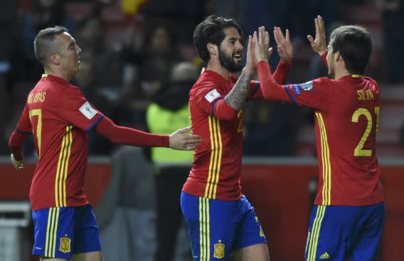 """Football Soccer – Spain v Israel – 2018 World Cup Qualifying European Zone – Group G – El Molinon Stadium, Gijon, Spain, 24/3/17 Spain's Francisco """"Isco"""" Alarcon (C) is congratulated by team mates David Silva (R) and Iago Aspas after scoring fourth goal. REUTERS/Eloy Alonso"""