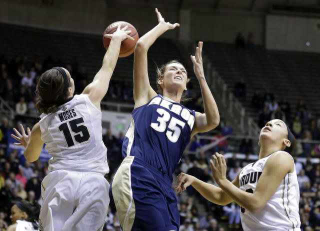 Akron forward Carly Young (35) has her shot blocked by Purdue guard Courtney Moses (15) as she shoots over Purdue forward Whitney Bays during the first half of a first-round game in the NCAA women's college basketball tournament, Saturday, March 22, 2014, in West Lafayette, Ind. (AP Photo/Michael Conroy)