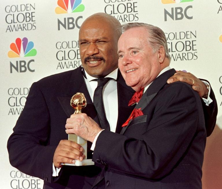 Actors Ving Rhames (L) and Jack Lemmon jointly hold the Golden Globe for best actor in a television movie in 1998 -- Rhames, the winner, decided to give it to Lemmon and refused to take it back