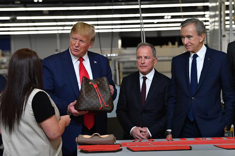 Donald Trump, Michael Burke, and Bernard Arnault visit the new Louis Vuitton factory in Johnson County, Texas on October 17, 2019.