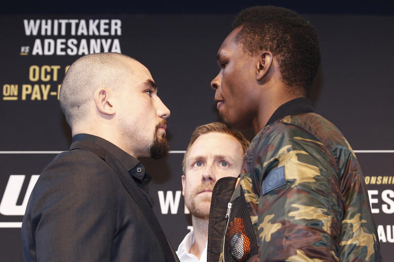 MELBOURNE, AUSTRALIA - AUGUST 15: Robert Whittaker (L) faces off with Israel Adesanya (R) during a UFC Australia press conference at Federation Square on August 15, 2019 in Melbourne, Australia. (Photo by Daniel Pockett/Zuffa LLC/Zuffa LLC via Getty Images)