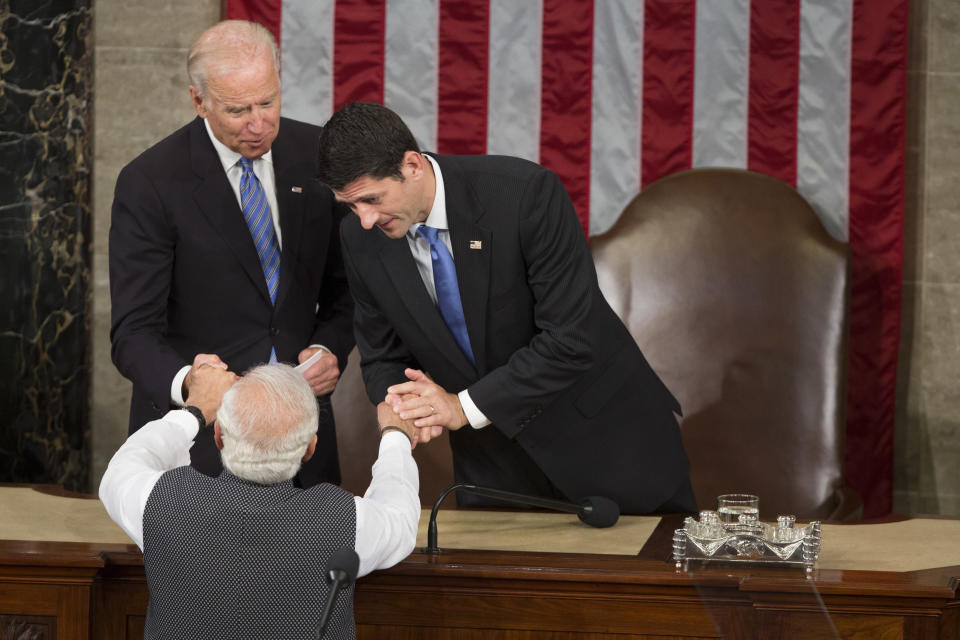 FILE - In this June 8, 2016, file photo, then U.S. Vice President Joe Biden and House Speaker Paul Ryan of Wis., right, shake hands with Indian Prime Minister Narendra Modi during his address to a joint meeting of Congress on Capitol Hill in Washington. India has high hopes its ties with the United States will deepen under President Joe Biden, who was a key proponent of the 2008 civil nuclear deal between the countries and whose new administration includes several Indian Americans. (AP Photo/Evan Vucci, File)