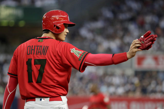 Los Angeles Angels' Shohei Ohtani gestures from first base during the third inning of the team's baseball game against the New York Yankees, Saturday, May 26, 2018, in New York. (AP Photo/Julio Cortez)
