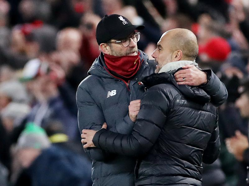 "Soccer Football - Premier League - Liverpool v Manchester City - Anfield, Liverpool, Britain - November 10, 2019 Liverpool manager Juergen Klopp with Manchester City manager Pep Guardiola at the end of the match Action Images via Reuters/Carl Recine EDITORIAL USE ONLY. No use with unauthorized audio, video, data, fixture lists, club/league logos or ""live"" services. Online in-match use limited to 75 images, no video emulation. No use in betting, games or single club/league/player publications. Please contact your account representative for further details."