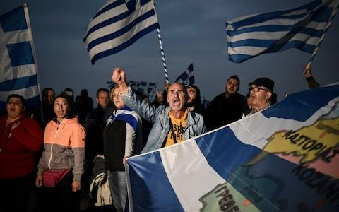 Greek protesters chant slogans against the name change deal during a rally in the Greek city of Thessaloniki, as Macedonians went to the polls - Credit: Giannis Papanikos/AP