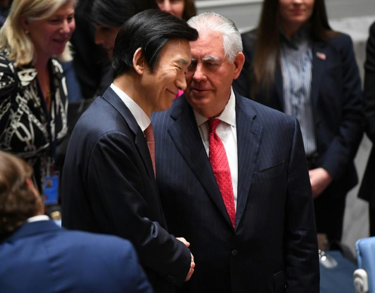 US Secretary of State Rex Tillerson (R) shakes hands with South Korea's Foreign Minister Yun Byung-se after a security council meeting on North Korea