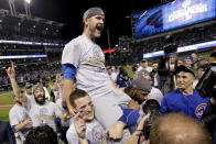 FILE- In this Nov. 3, 2016, file photo, Chicago Cubs catcher David Ross is carried by teammates after Game 7 of the Major League Baseball World Series against the Cleveland Indians in Cleveland. The Chicago Cubs have hired former catcher David Ross to replace Joe Maddon as their manager, hoping he can help them get back to the playoffs after missing out for the first since 2014. (AP Photo/Matt Slocum, File)