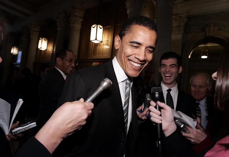 FILE - In this Nov. 16, 2004 file photo, then-Sen.-elect Barack Obama, D-Ill., is surrounded by reporters on Capitol Hill in Washington. The president's re-election campaign is increasingly sounding like a nostalgia tour. His speeches stroll through elections past, serving up fond memories of his days running as a political unknown, identifying early political inspirations and reminding voters that, win or lose, this will be his last campaign after 13 appearances on the ballot since 1996.   (AP Photo/Evan Vucci, File)