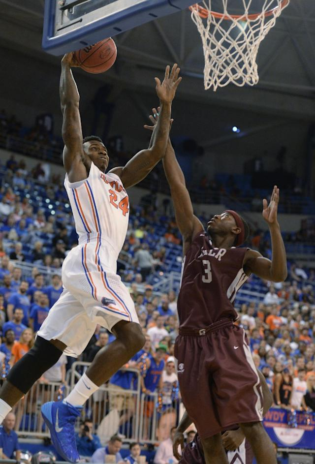 Florida forward Casey Prather (24) goes to the basket with Arkansas-Little Rock's Josh Hagins (3) defending during the first half of an NCAA college basketball game Saturday, Nov. 16, 2013, in Gainesville, Fla. (AP Photo/Phil Sandlin)