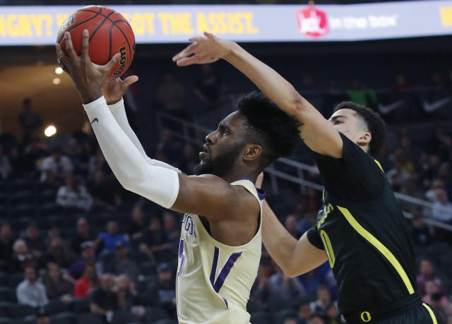 Washington's Jaylen Nowell shoots around Oregon's Will Richardson during the first half of an NCAA college basketball game in the final of the Pac-12 men's tournament Saturday, March 16, 2019, in Las Vegas. (AP Photo/John Locher)