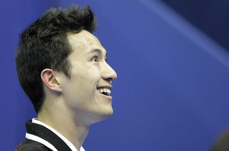 Patrick Chan of Canada reacts after performing his men short program at the 2012 World Figure skating Championships in Nice, southern France, Friday, March 30, 2012. Chan's bid to become the first man to win back-to-back world figure skating titles since Stephane Lambiel of Switzerland in 2006 gets underway with the short program. Meanwhile, three-time winners and defending champions Aliona Savchenko and Robin Szolkowy of Germany are favorites to win the pairs after the free. (AP Photo/Lionel Cironneau)