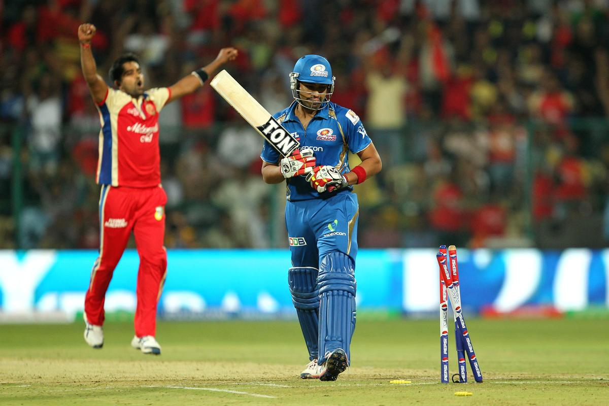 Vinay Kumar celebrates wicket of Rohit Sharma during match 2 of of the Pepsi Indian Premier League between The Royal Challengers Bangalore and The Mumbai Indians held at the M. Chinnaswamy Stadium, Bengaluru on the 4th April 2013Photo by Prashant BhootSPORTZPICS Use of this image is subject to the terms and conditions as outlined by the BCCI. These terms can be found by following this link:https://ec.yimg.com/ec?url=http%3a%2f%2fwww.sportzpics.co.za%2fimage%2fI0000SoRagM2cIEc&t=1490292399&sig=l8P65R5awwTf_ivFJ_6dTQ--~C