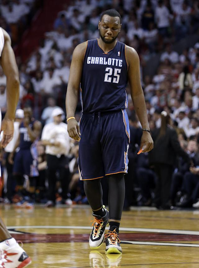 Charlotte Bobcats' Al Jefferson walks on the court during the second half in Game 2 of an opening-round NBA basketball playoff series against the Miami Heat, Wednesday, April 23, 2014, in Miami. The Heat defeated the Bobcats 101-97. (AP Photo/Lynne Sladky)