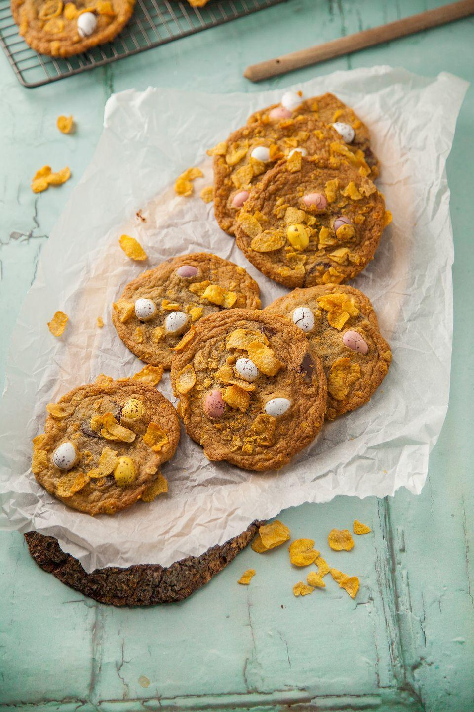 """<p>These biscuits are a twist on classic cornflake cakes. Adding the breakfast cereal gives a nice crunch to these cookies, and they're super fun to make with the kids.</p><p><strong>Recipe: <a href=""""https://www.goodhousekeeping.com/uk/food/recipes/a26582918/chocolate-cornflake-cookies/"""" rel=""""nofollow noopener"""" target=""""_blank"""" data-ylk=""""slk:Chocolate cornflake and mini egg cookies"""" class=""""link rapid-noclick-resp"""">Chocolate cornflake and mini egg cookies</a></strong></p>"""
