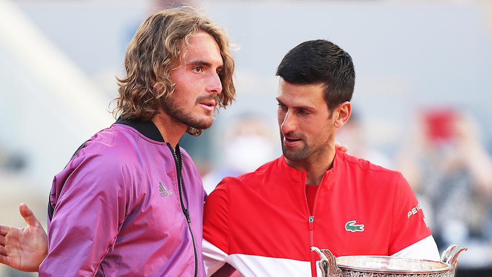 Stefanos Tsitsipas (pictured left) being embraced by Novak Djokovic (pictured right) after the Roland Garros final.