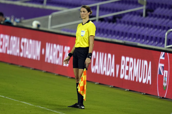 Assistant referee Kathryn Nesbitt watches play between Bermuda and Canada during the first half of a World Cup 2022 Group B qualifying soccer match, Thursday, March 25, 2021, in Orlando, Fla. Nesbitt, a 32-year-old from Philadelphia, had a breakthrough moment when she became the first woman to work as an on-field official for a World Cup qualifier in North and Central America and the Caribbean. (AP Photo/John Raoux)