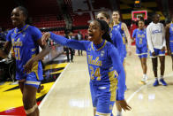 UCLA guard Japreece Dean (24) celebrates after the team's second-round game against Maryland in the NCAA women's college basketball tournament Monday, March 25, 2019, in College Park, Md. UCLA won 85-80. (AP Photo/Patrick Semansky)