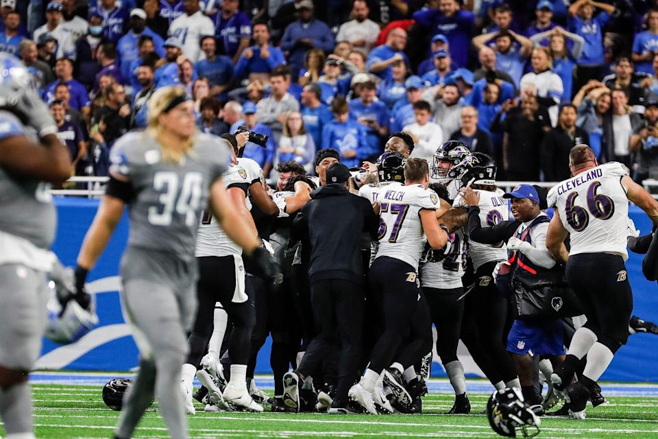 Baltimore Ravens players celebrate kicker Justin Tucker's 66-yard field goal against the Detroit Lions at Ford Field in Detroit on Sunday, Sept. 26, 2021.