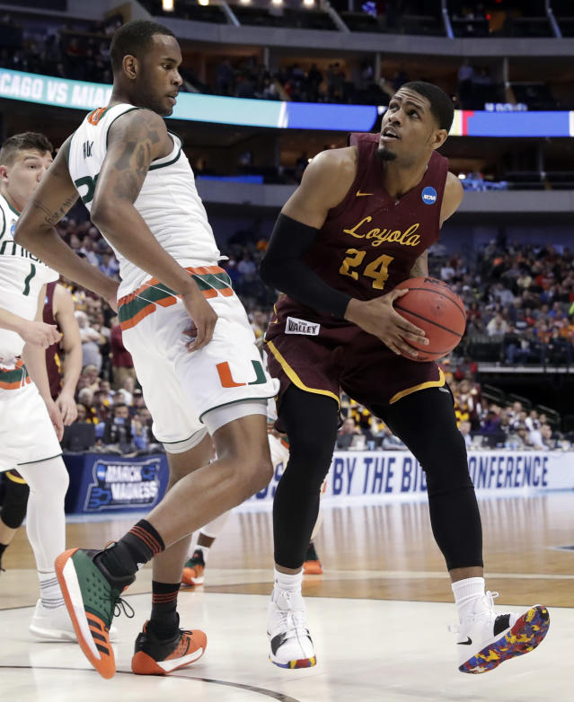 Miami forward Dewan Huell (20) defends as Loyola-Chicago forward Aundre Jackson (24) works for a shot attempt in the first half of a first-round game at the NCAA college basketball tournament in Dallas, Thursday, March 15, 2018. (AP Photo/Tony Gutierrez)
