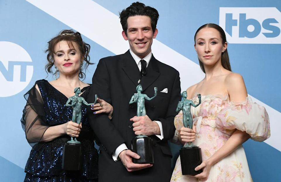 "Helena Bonham Carter, Josh O'Connor and Erin Doherty pose with the trophy for Outstanding Performance by an Ensemble in a Drama Series for ""The Crown"" in the press room during the 26th Annual Screen Actors Guild Awards at The Shrine Auditorium on January 19, 2020 in Los Angeles, California"