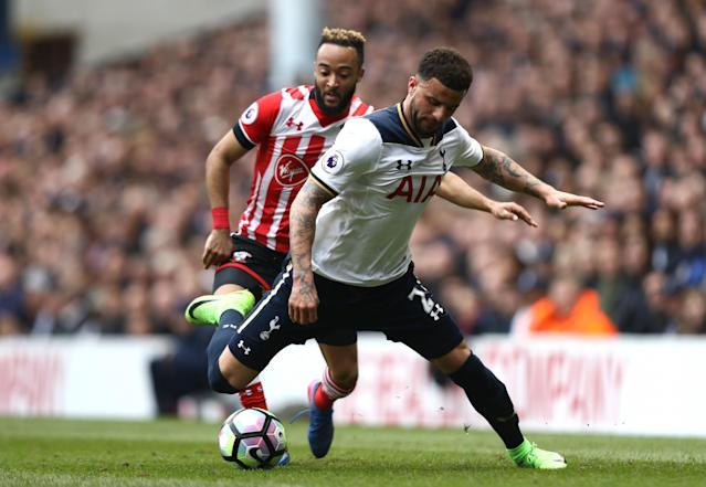 <p>Kyle Walker deals with the ball under pressure from Redmond </p>