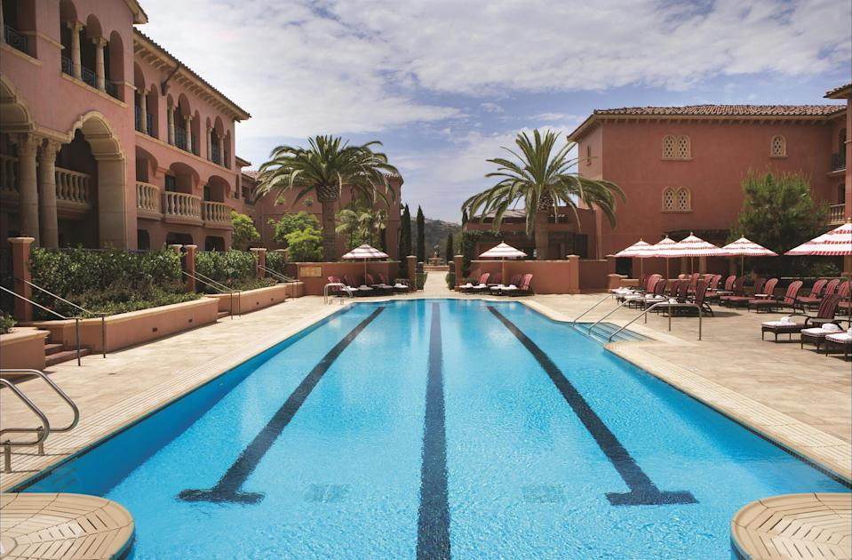 """<p><strong>Why did this hotel catch your attention?</strong><br> Fairmont Grand Del Mar is grand indeed; the majestic 400-acre resort, operated by the team behind <a href=""""https://www.cntraveler.com/hotels/united-states/new-york-city/the-plaza--new-york?mbid=synd_yahoo_rss"""" rel=""""nofollow noopener"""" target=""""_blank"""" data-ylk=""""slk:The Plaza, in New York City"""" class=""""link rapid-noclick-resp"""">The Plaza, in New York City</a>, and The Savoy, has a luxurious Mediterranean vibe thanks to a rose-colored facade, intricate ironwork, roof tiles, copper accents, and towering cypress and palm trees. It feels a little like a palace in Spain or France —with California burritos and great surf just a few miles away. It's an antidote to anyone tired of overly slick, minimalist hotels geared toward millennials.</p> <p><strong>What's the backstory?</strong><br> Inspired by the architecture of Addison Mizner, best known for his 1920s-era designs of mansions in Palm Beach, Calif., and Boca Raton, Fla., the design of Fairmont Grand Del Mar combines opulence with a laid-back SoCal feel.</p> <p><strong>Tell us all about the accommodations. Any tips on what to book?</strong><br> The 249 rooms are divided into 500-square-foot guest rooms, 1,000-square-foot suites, and 5,000-square-foot villas. No matter the size, the decor is all Old World luxury—brocade upholstery, crystal lamp bases, and marble counters. Rooms and suites come with views of the well-manicured grounds or the pool; the two-story villas have private outdoor patios overlooking the golf course.</p> <p><strong>Is there a charge for Wi-Fi?</strong><br> The $45 resort fee includes Wi-Fi. You can bump up to faster speeds for $10, but the standard should do just fine.</p> <p><strong>Drinking and dining—what are we looking at?</strong><br> <a href=""""https://www.cntraveler.com/restaurants/san-diego/the-addison?mbid=synd_yahoo_rss"""" rel=""""nofollow noopener"""" target=""""_blank"""" data-ylk=""""slk:Addison"""" class=""""link rapid-noclick-resp"""">Addison</a>, the"""