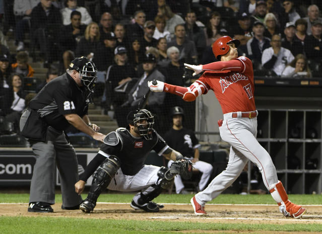 Los Angeles Angels' Shohei Ohtani (17) watches his three-run home run against the Chicago White Sox during the third inning of a baseball game, Friday, Sept. 7, 2018, in Chicago. (AP Photo/David Banks)