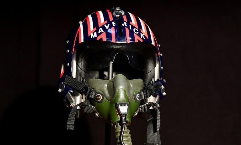 "Items up for auction at the Prop Store Auction in late August are on display at the Prop Store in Valencia, California on July 15, 2020 include the helmet worn by actor Tom Cruise in the movie ""Top Gun"", estimated at $50,000 70,000 USD"