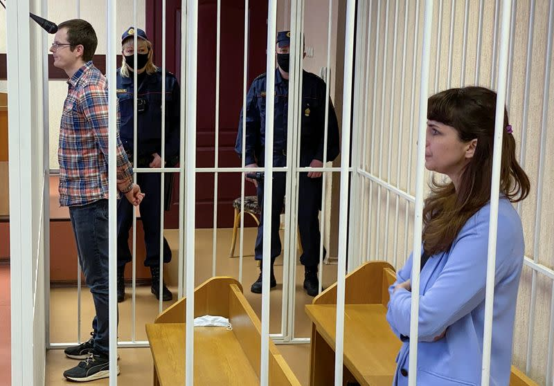 Journalist Katerina Borisevich and doctor Artyom Sorokin attend a court hearing in Minsk