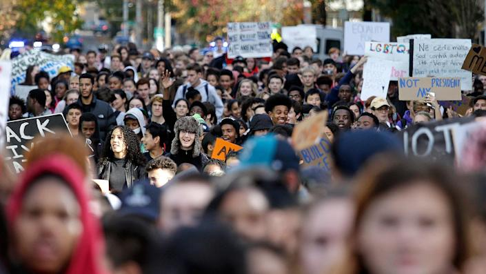 <p>High school students fill a street as they head to join others during a walkout to protest the election of Donald Trump as president, Monday, Nov. 14, 2016, in Seattle. (AP Photo/Elaine Thompson) </p>